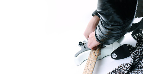 Care for a guitar with empty place for your text isolated on white background