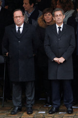 Former French Presidents Francois Hollande and Nicolas Sarkozy, French Finance Minister Bruno Le Maire and Minister of Ecological and Social Transition Nicolas Hulot wait prior to a national tribute for late Gendarmerie officer Colonel Arnaud Be