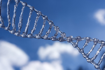 spiral dna against the blue sky with clouds