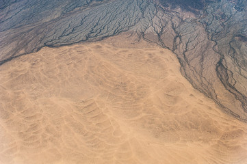 Aerial window view over the Atacama desert showing amazing patterns, good as background image