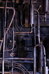 Dark industrial interior with metal rusty old pipes