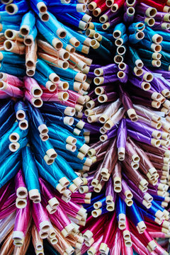 Large number of threads painted in different colors and shades in Morocco. Variety of shades of silk threads for sewing. Fabulous Morocco
