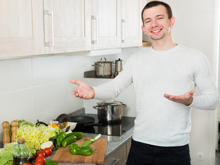 Male cooking with vegetables