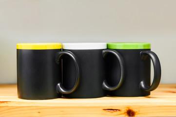 kitchen dishes black mugs on wooden shelf