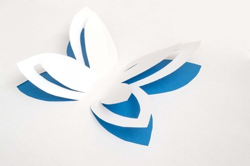 blue paper butterfly flapping its wings