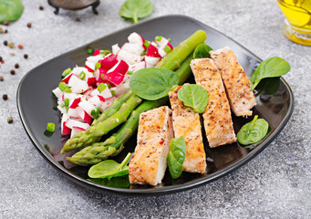 Chicken fillet cooked on a grill with a garnish of asparagus and radish salsa. Dietary menu. Healthy food