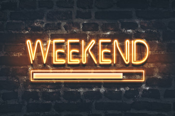 Weekend loading neon sign on dark brick wall background Wall mural