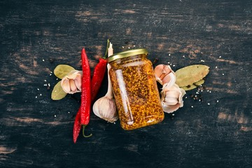Grain Mustard. Spices On a dark wooden background. Top view. Copy space for your text.