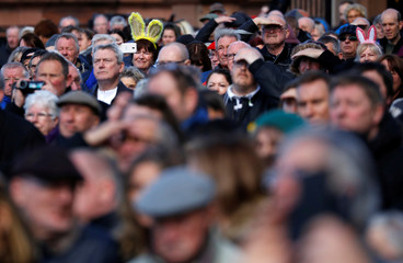 People wear novelty ears at Ken Dodd's funeral at Liverpool Cathedral, in Liverpool