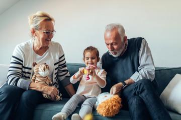 Playtime with her grandma and grandpa