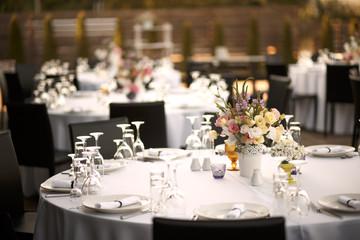 Formal dinner service at a outdoor wedding banquet