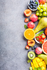 Spoed Fotobehang Vruchten Fresh assorted fruits and berries on light gray background. Colorful clean and healthy eating. Detox food. Copy space. Top view.