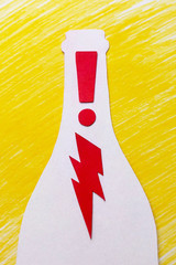 The energy thirst of the red lightning in the bottle and the exclamation mark on a yellow background symbol image