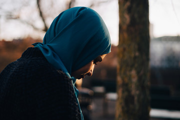 Side view of young woman wearing hijab
