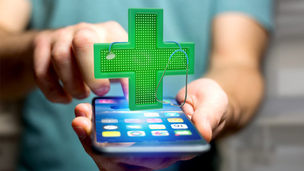 Businessman using a smartphone with a Lighting pharmacy cross and a stethoscope - 3d render