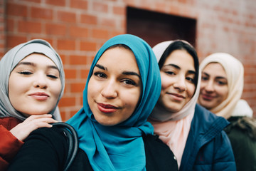 Portrait of young women in headscarves