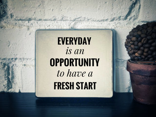 Motivational and inspirational quotes - Everyday is an opportunity to have a fresh start. With vintage styled background.