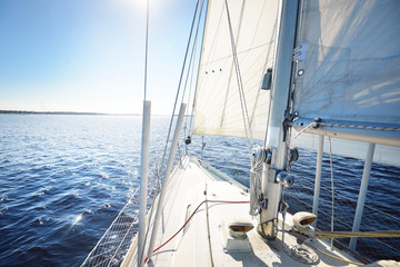 View from the bow of a yacht as the vawes are sparkling