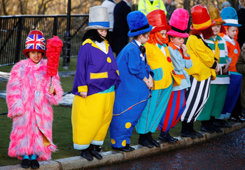 "Children wearing ""Diddy Men"" costumes, a character popularized by Ken Dodd, line up after the comedian's funeral at Liverpool Cathedral, in Liverpool"
