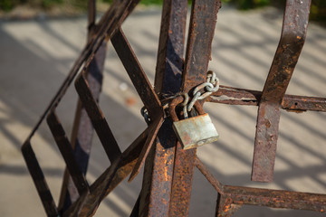 Metal Padlock and Chain attached to Rusty Railings