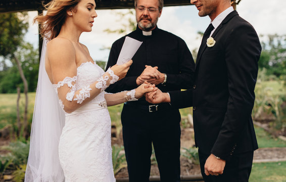 Couple exchanging vows on wedding ceremony
