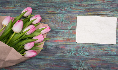 Pink tulips flowers on wooden background selective focus place for text