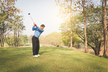 Man playing golf on a golf course.
