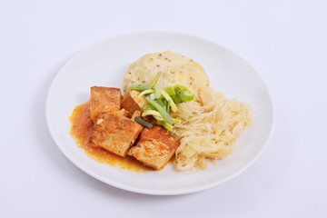 Tofu with cabbage and rice dumplings  on a white