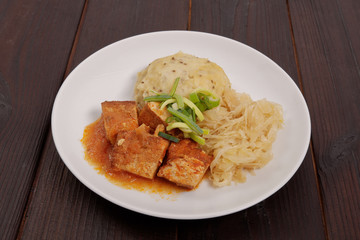 Tofu with cabbage and rice dumplings  on a table
