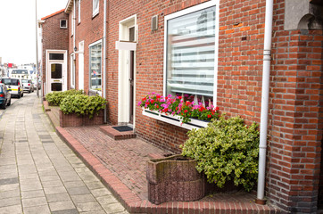 Red Brick Houses along a Stone Sidewalk in the Seaside Resort Town of Zandwoort, The Netherlands