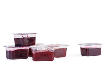 Small plastic containers with strawberry jam