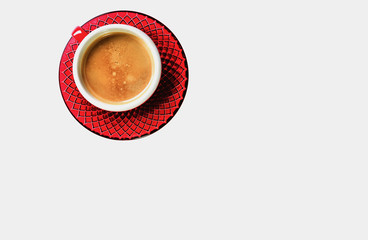 Red cup with aromatic coffee. Isolation in white.