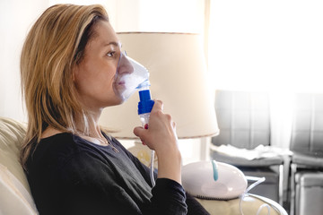 nebulizer aerosol woman inhaler machine medicine at home
