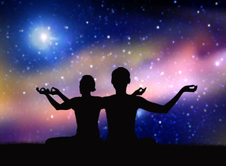 yoga, mindfulness and harmony concept - black silhouette of couple meditating over space background
