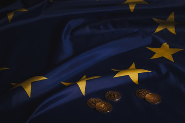 Golden bitcoins on  EU flag