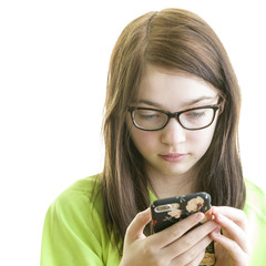 Close up portrait of a brunette young caucasian teenage girl using smartphone isolated on a white background