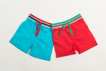 Blue and red shorts for swimming for men or children