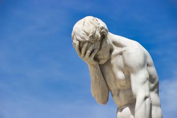 Desperation. Guilt. Facepalm Statue of Cain by Henri Vidal, Jardin des Tuileries, Paris