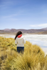 Young woman at Laguna Hedionda in Bolivia