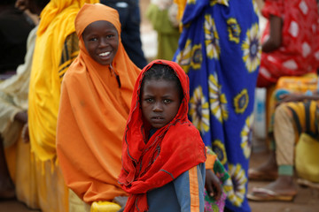 Ethiopian girls wait in line to collect water at the Somare refugee camp on the Ethiopian-Kenyan border near the town of Moyale
