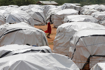 An Ethiopian girl walks past tents in the Dambala Fuchana refugee camp near the Ethiopian-Kenyan border town of Moyale