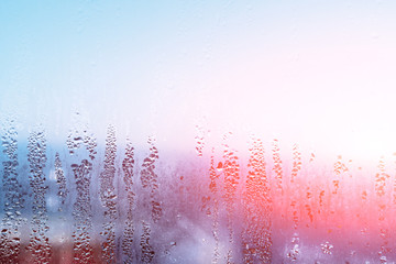 High humidity and condensate in drop of natural water on window, cold tone can be used as background or texture