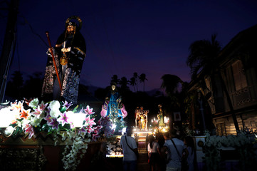 Devotees parade religious images during Holy Week celebrations in Pola