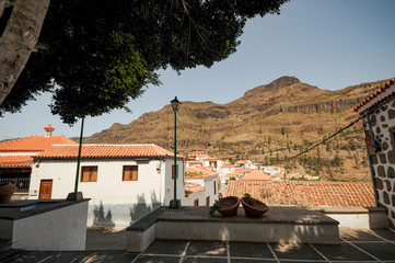 little village on Gran Canaria a spanish island in europe spain a famous vacation with colorful landscapes for travel in spain. From the desert to beautiful oases with palms, cacti and aloe vera.