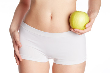 close up of wellness female body holding a green apple