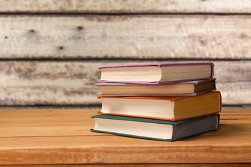 Stack books on wooden desk