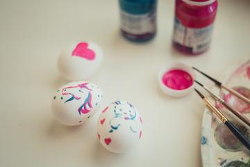 The Easter eggs paintings on white desk