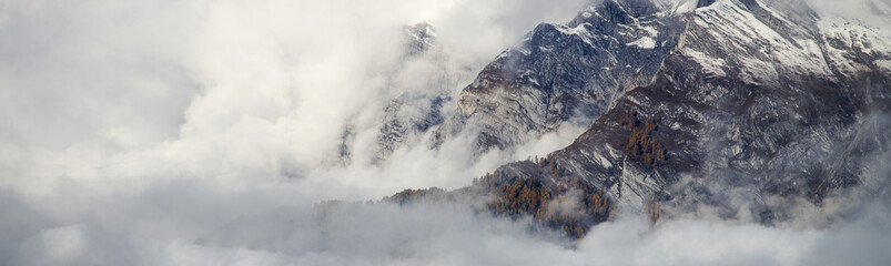 Foto op Aluminium Wit Aerial image of beautiful mountain landscape with clouds in the Valais Kanton