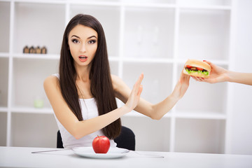 Choose between junk food versus healthy diet