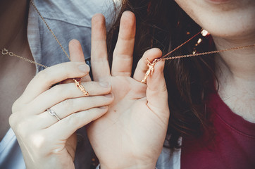 pendants in girls hands of angel statue mormon